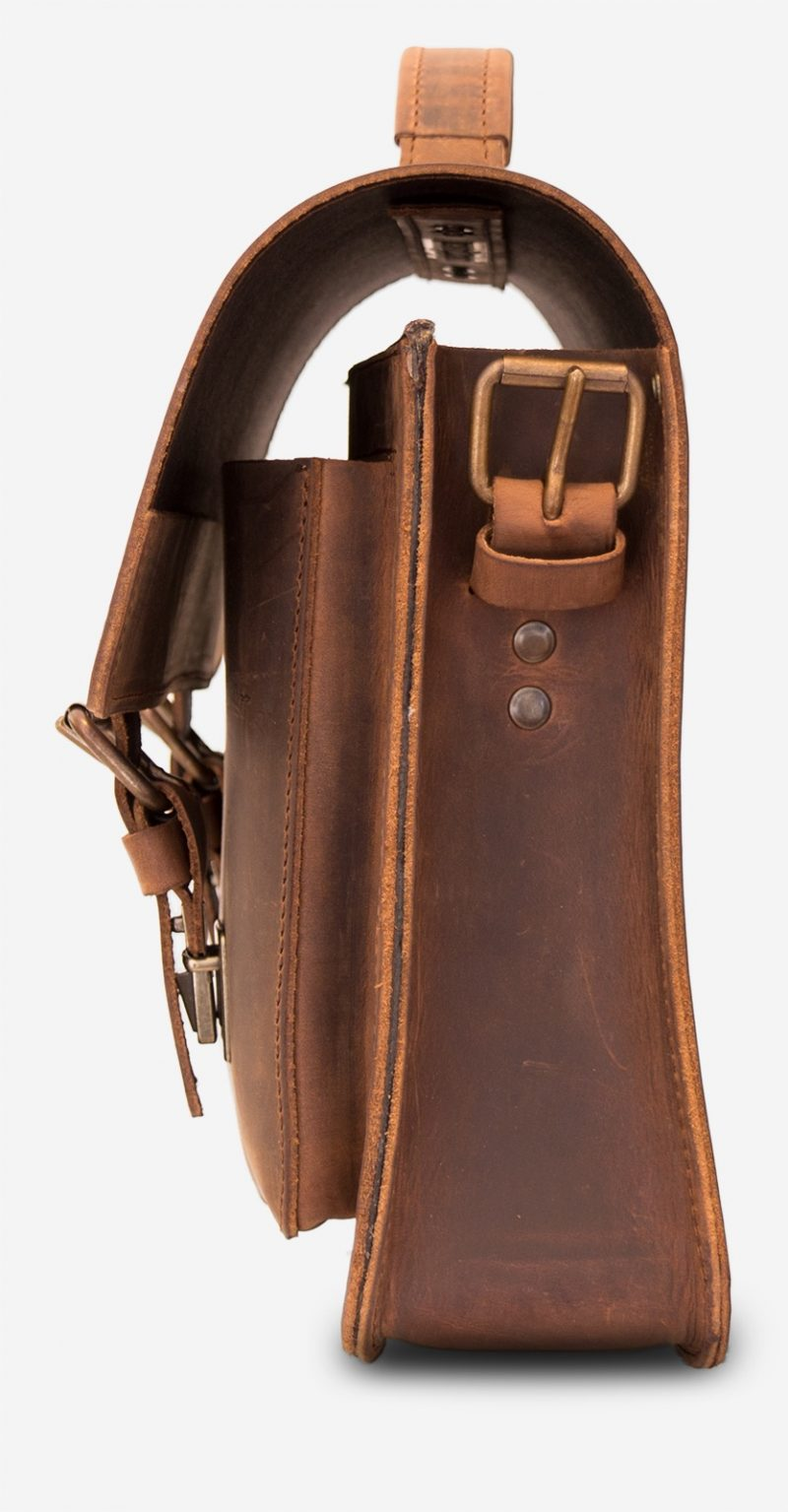 Side view of the brown leather briefcase with one main compartment and one front pocket.