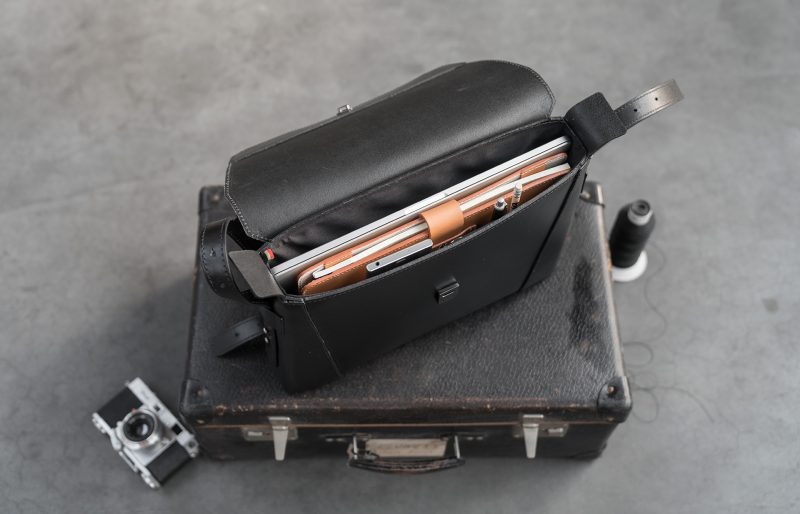 Top view of the slim vegetable-tanned black leather briefcase bag.
