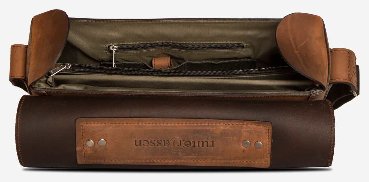 Inside view of the vegetable-tanned brown leather briefcase bag with laptop pocket.