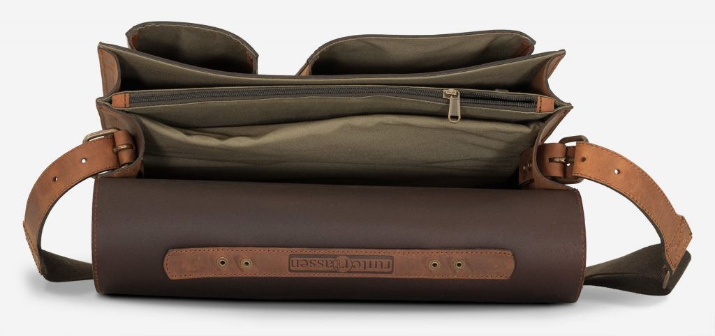 Inside view of 2 compartments brown leather satchel briefcase with laptop pocket.