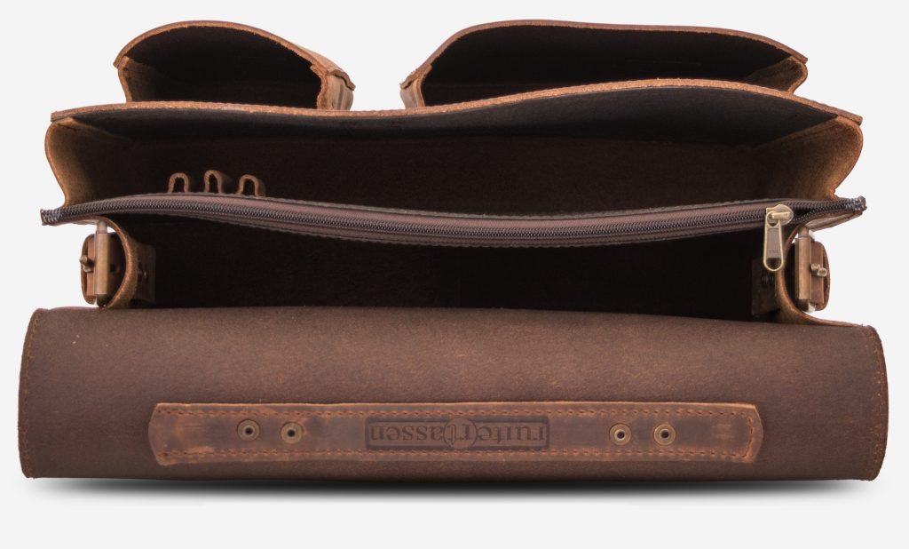 Inside view of the brown leather satchel with 2 main compartments, pen loops and two asymmetric front pockets.
