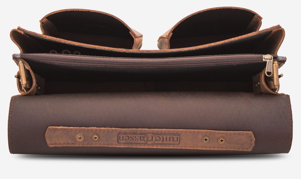 Inside view of the brown leather satchel with 2 main compartments and two front pockets.