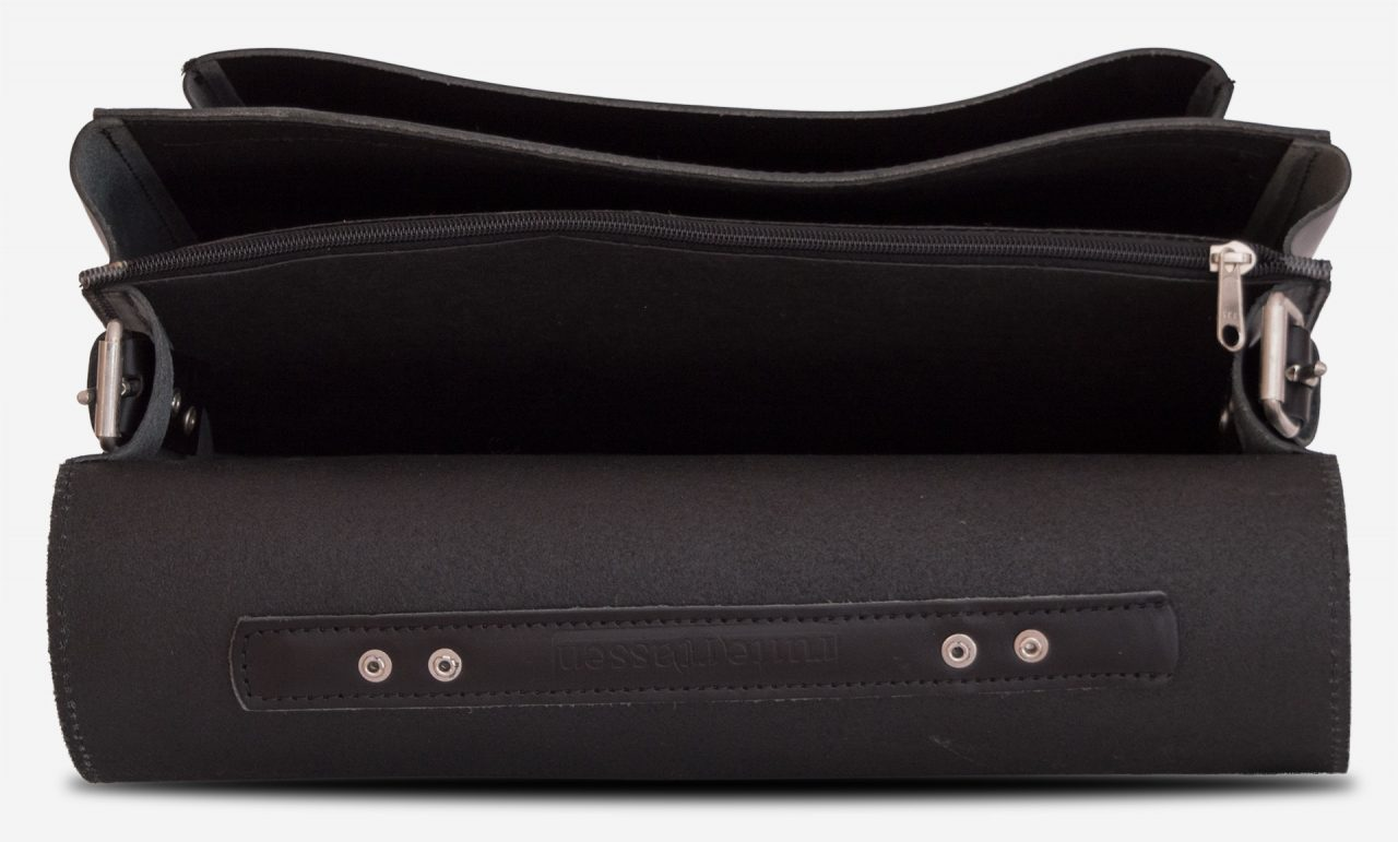 Inside view of black leather student satchel with 2 gussets and large front pocket 112140.