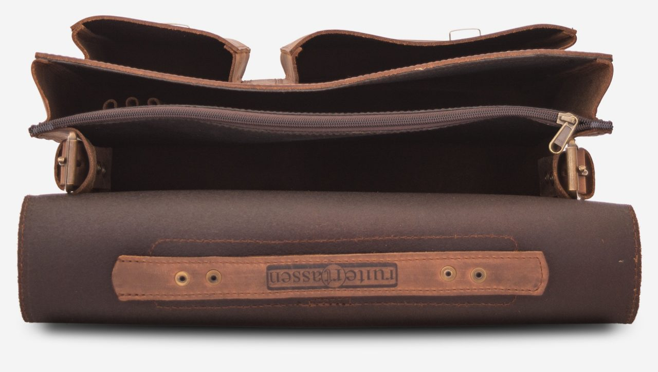 Inside view of large 2 compartments brown leather satchel with 2 front asymmetric pockets.
