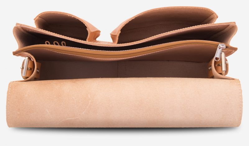 Inside view of 2 compartments tan leather messenger bag.