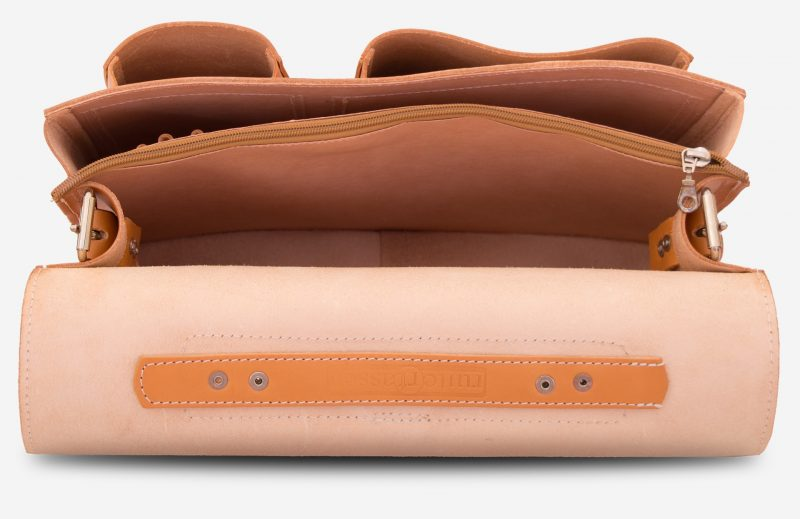 Inside view of large 2 compartments tan leather satchel with 2 front asymmetric pockets.
