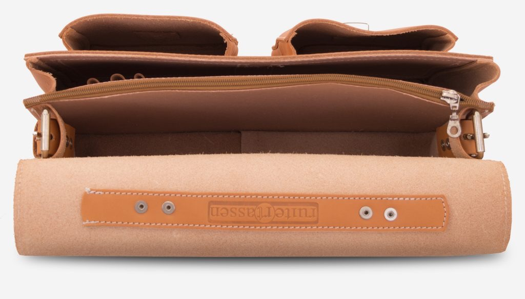 Inside view of the tan leather satchel with 2 main compartments and two front pockets.
