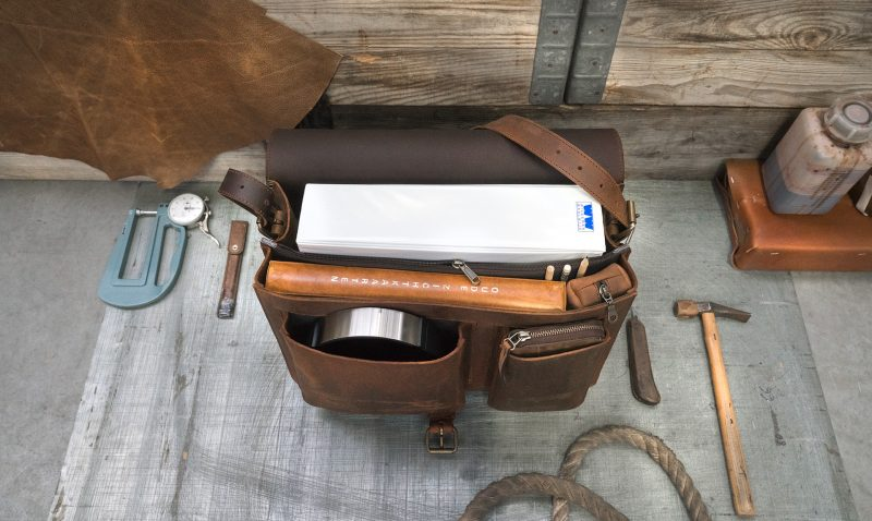 Inside view of 2 compartments brown leather messenger bag.