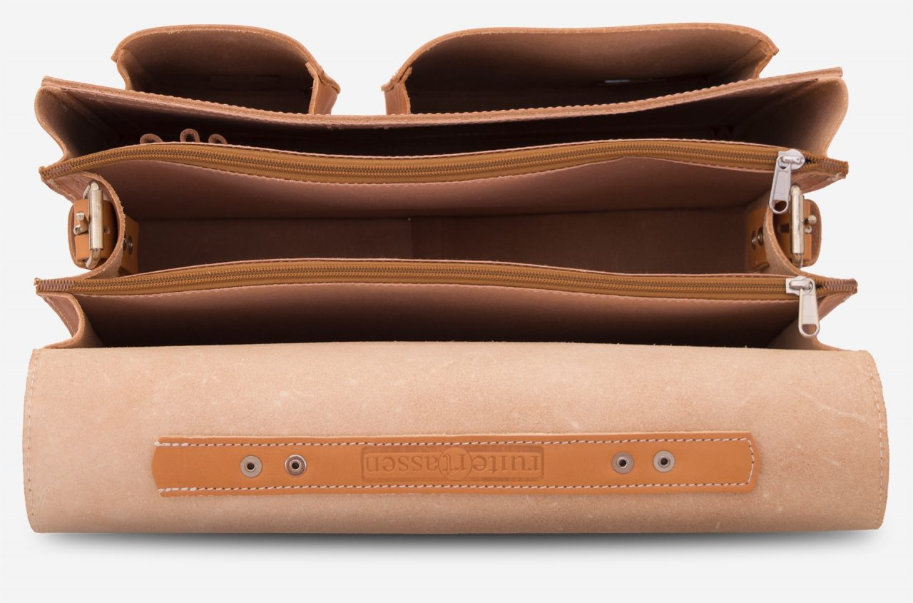 Inside view of large 3 compartments tan leather satchel with 2 front asymmetric pockets.