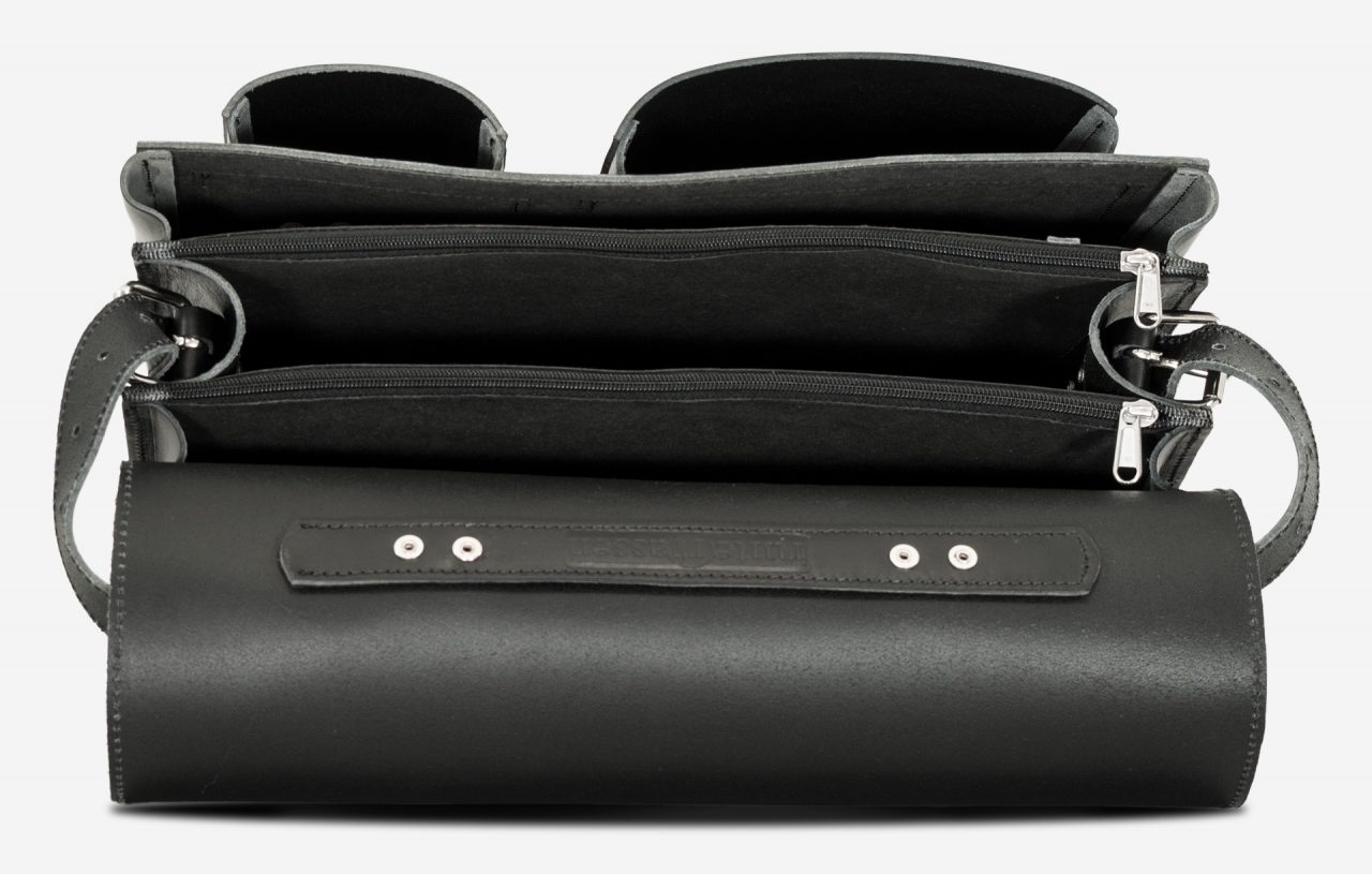 Inside view of large black leather briefcase with 3 compartments and asymmetric front pockets 112142.
