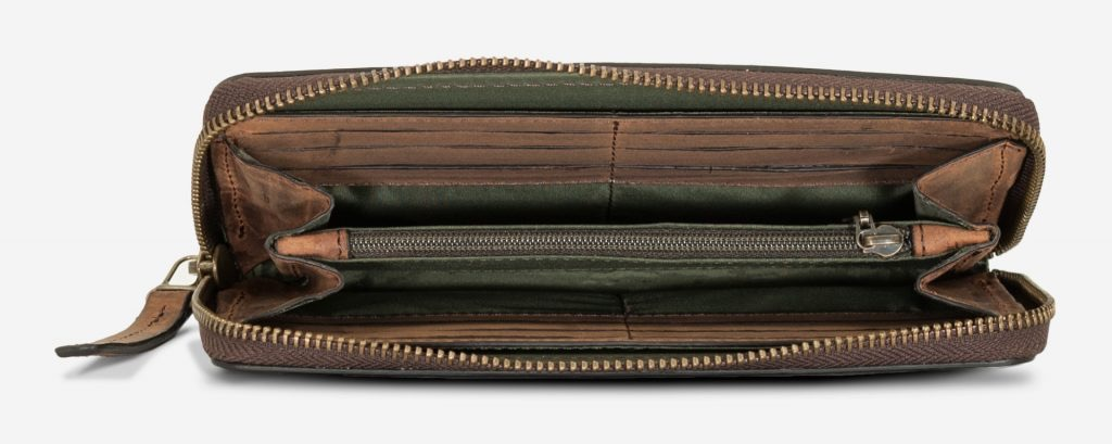 Long brown vegetable-tanned leather wallet opened.