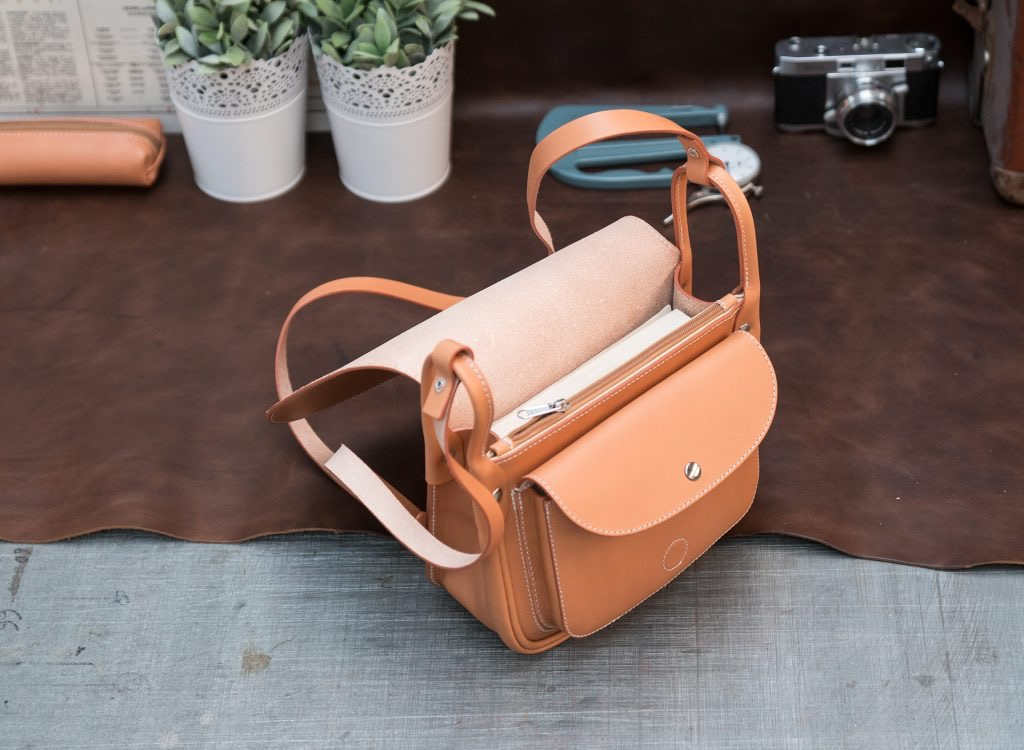 Top view of the elegant tan leather shoulder bag for women.