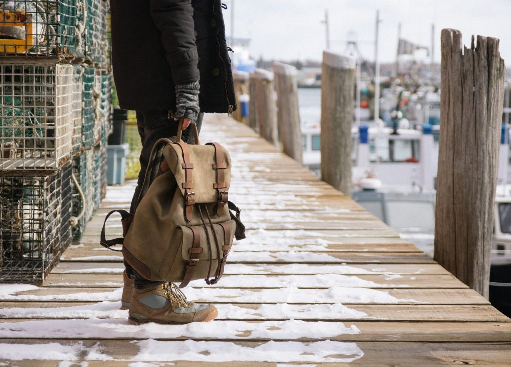 Man wearing the beautiful soft leather backpack.