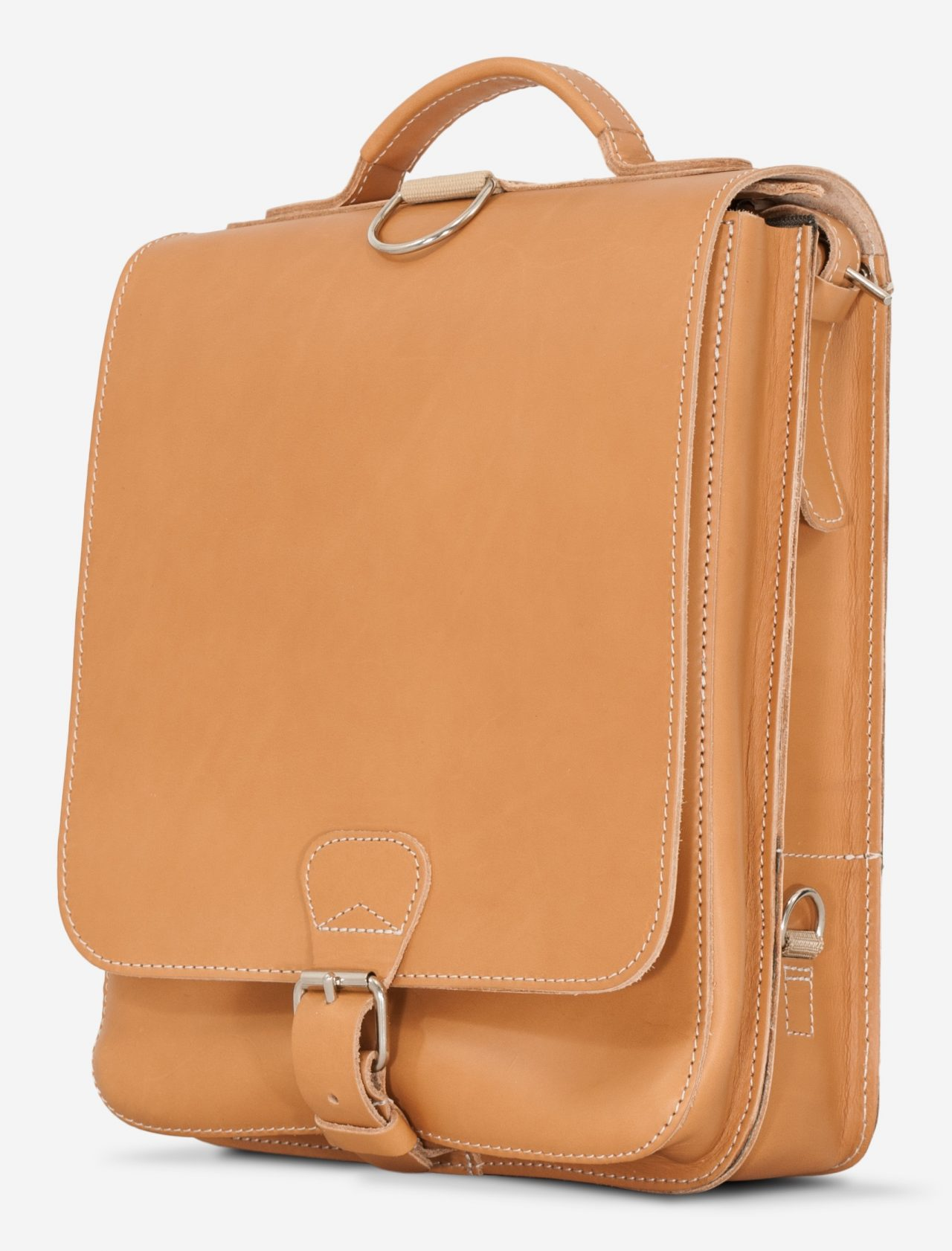 Side view of the vegetable tanned leather backpack with shoulder belt.
