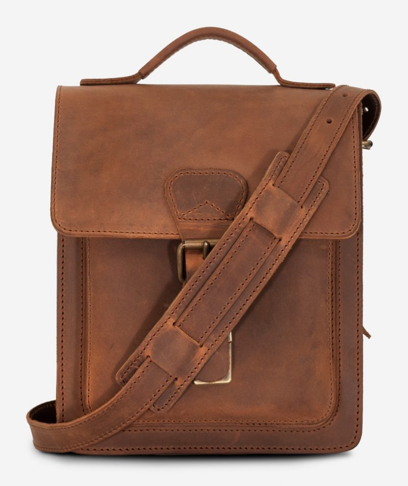Front view of the handmade vegetable-tanned brown leather crossbody bag for men.