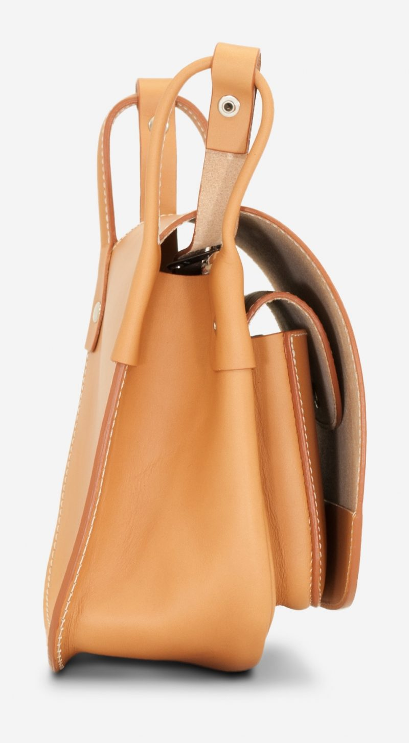 Side view of the elegant tan leather shoulder bag for women.