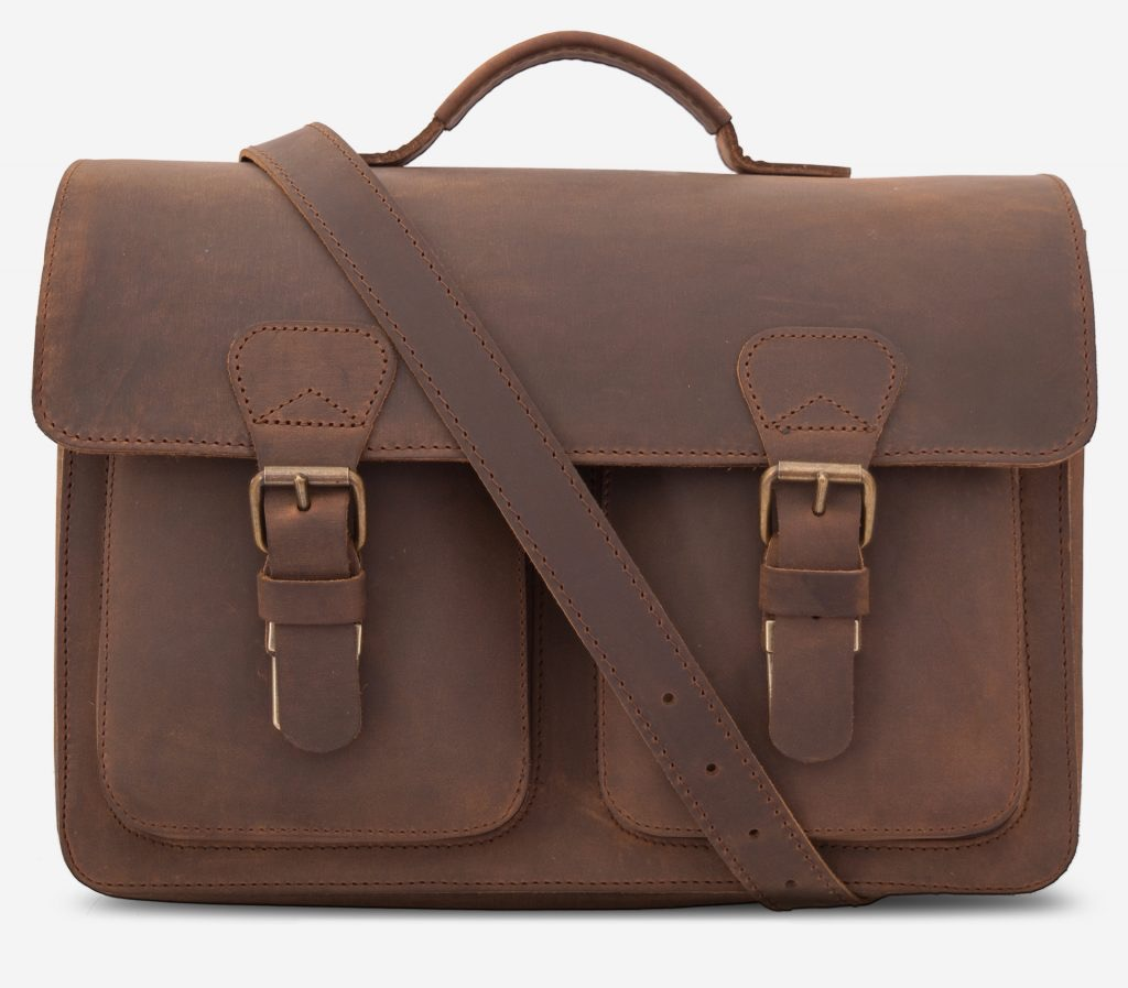 Front view of the brown leather professor satchel with shoulder belt.