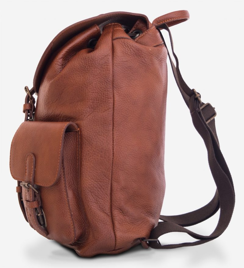 Side view of the elegant brown soft leather backpack.