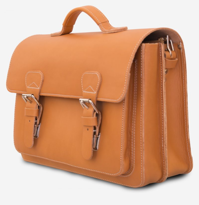Side view of the student tan leather satchel with 2 compartments and 1 front pocket.