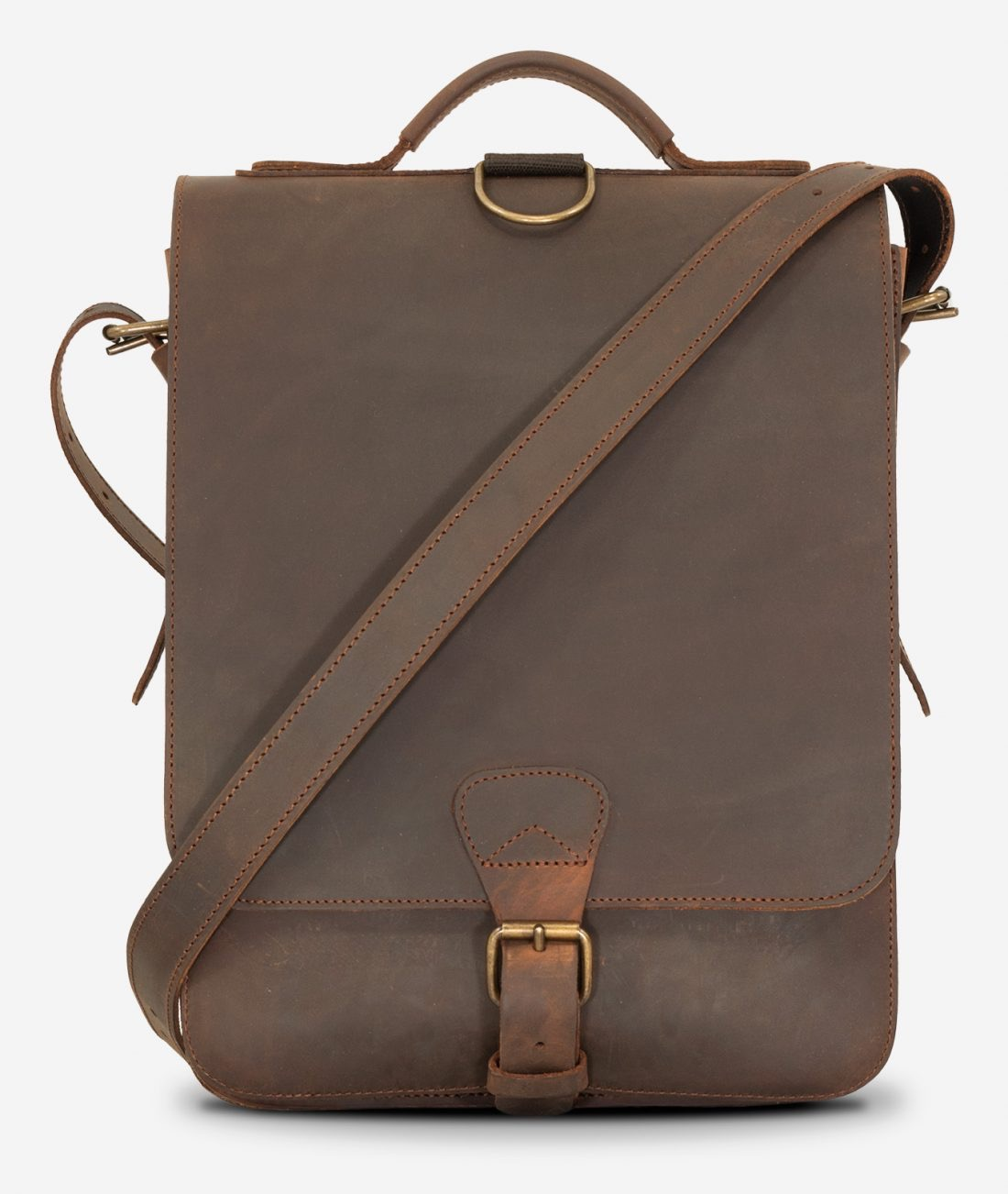Front view of the vegetable-tanned brown leather backpack with shoulder belt.