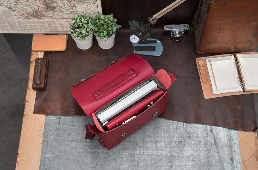 Top view of the elegant red vegetable-tanned leather briefcase bag with laptop pocket for women.