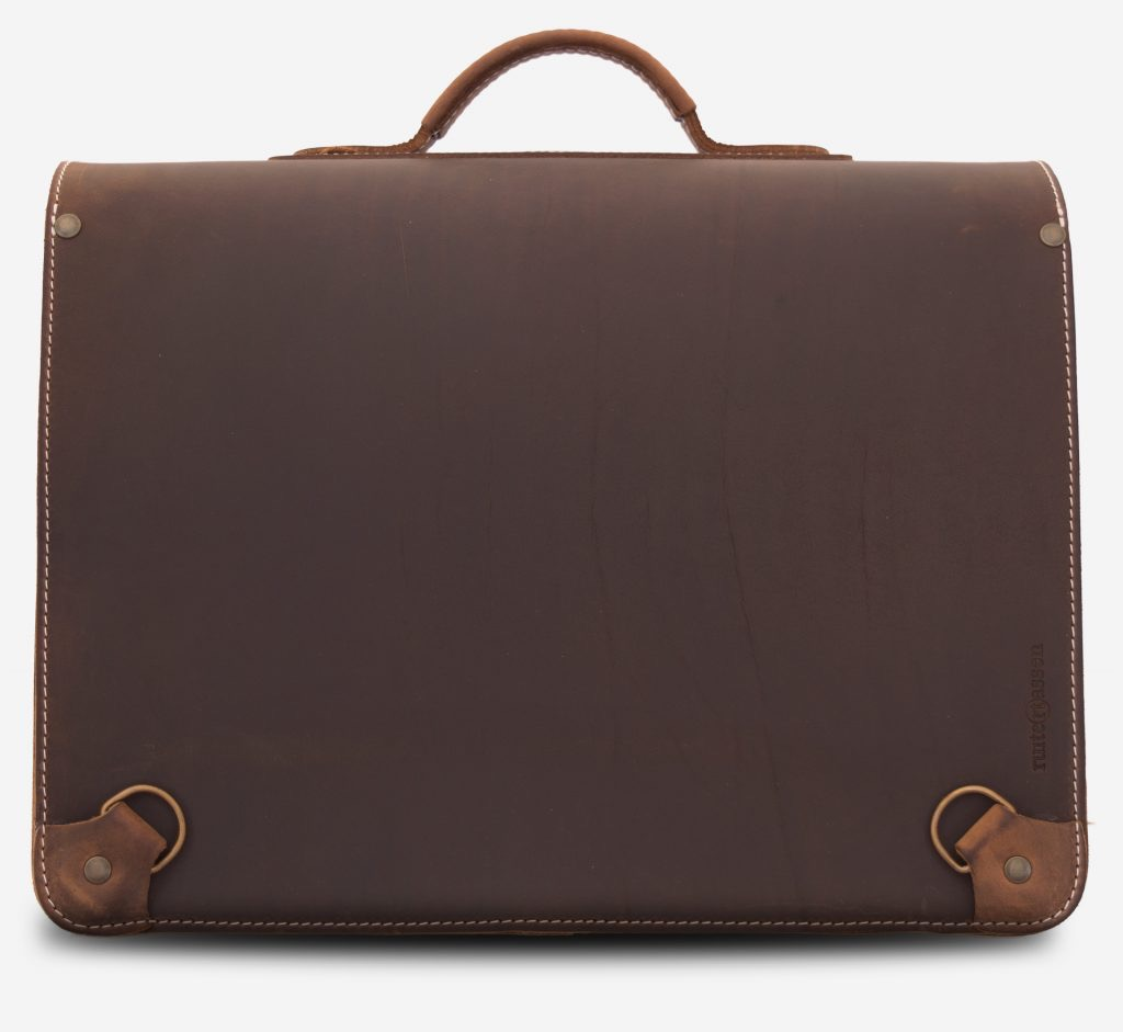 Back view of brown leather satchel backpack fitted with shoulder strap hooks.