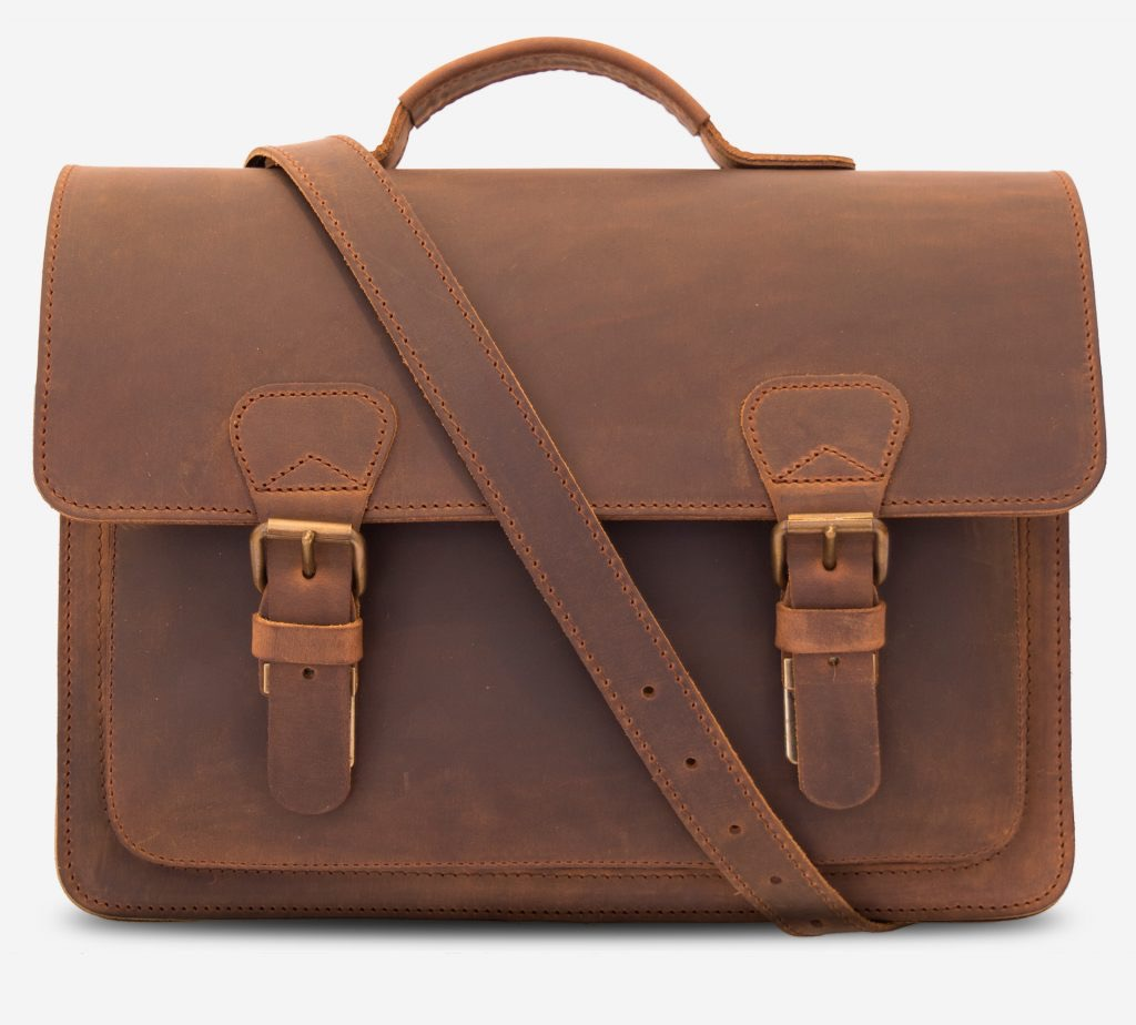 Front view of the vintage brown leather briefcase with shoulder strap.