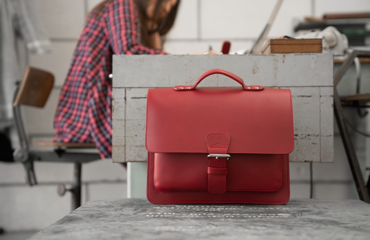 Student in office with red leather briefcase with single compartment and large front pocket for women - 152141.