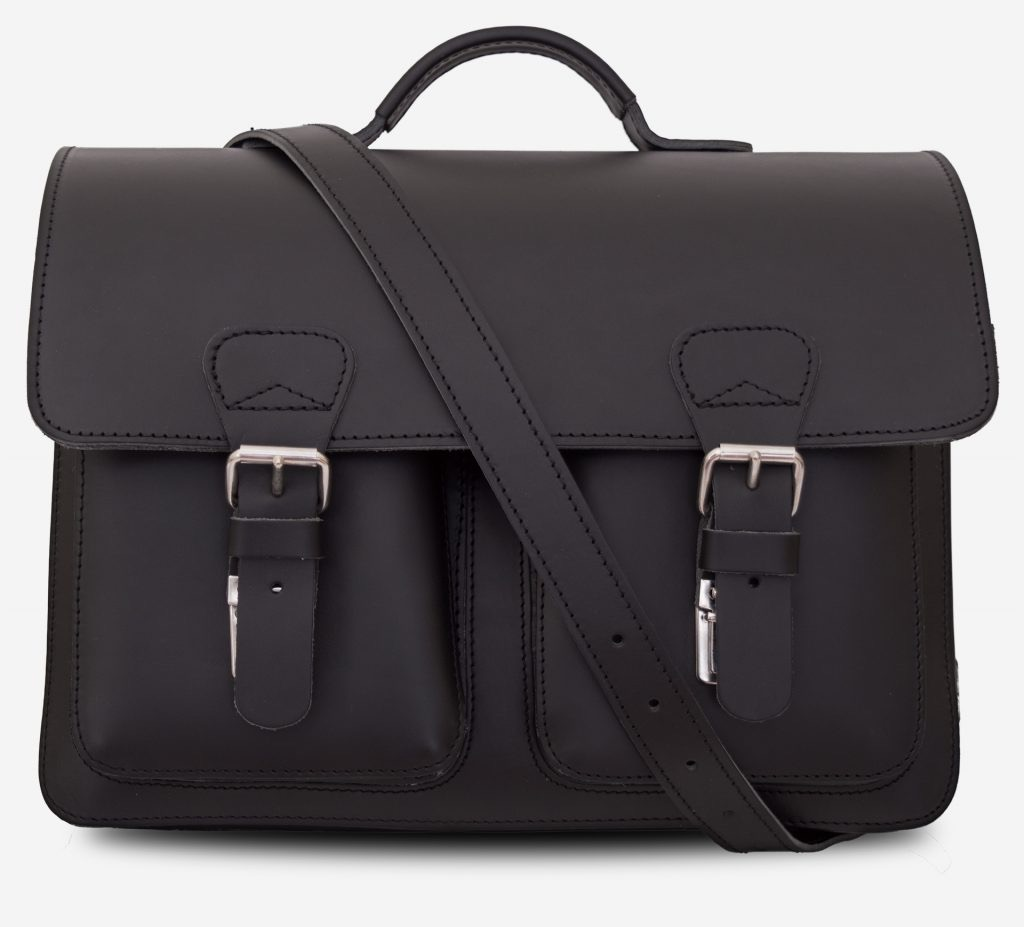 Front view of black leather satchel briefcase with 3 gussets, symmetric front pockets and shoulder strap 112139.