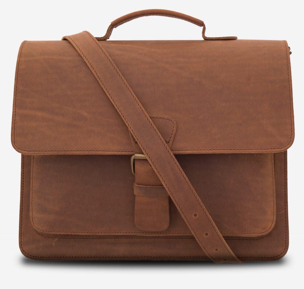 Front view of the full-grain brown leather briefcase with leather strap across.