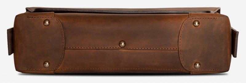 Below view of the vegetable-tanned brown leather briefcase bag with laptop pocket.