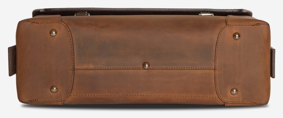 Below view of the large vegetable-tanned brown leather briefcase bag with laptop pocket.