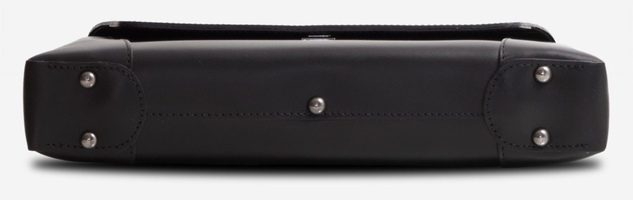 Below view of the slim vegetable-tanned black leather briefcase bag.