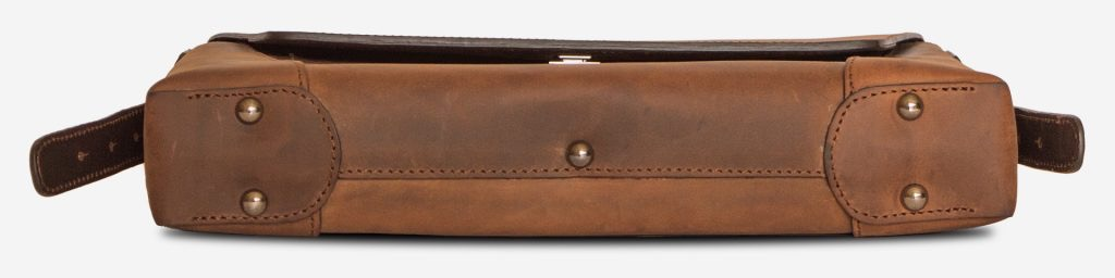 Below view of the slim vegetable-tanned brown leather briefcase bag.