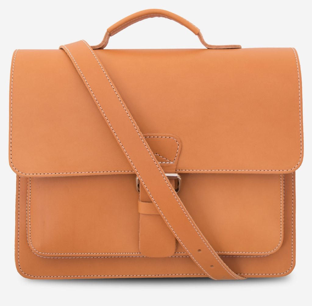 Front view of the full-grain tan leather briefcase with leather strap across.