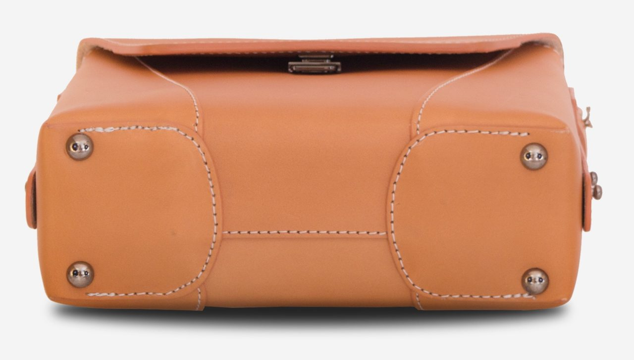 Below view of the small vegetable tanned leather crossbody bag.
