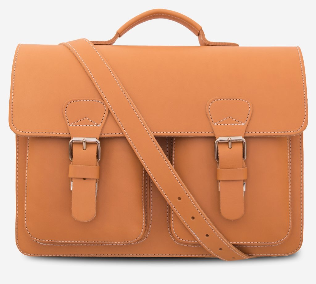 Front view of the tan leather professor satchel with shoulder belt.