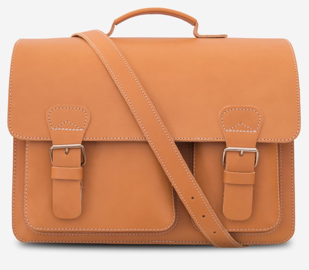 Front view of large tan leather satchel briefcase with a leather shoulder strap.