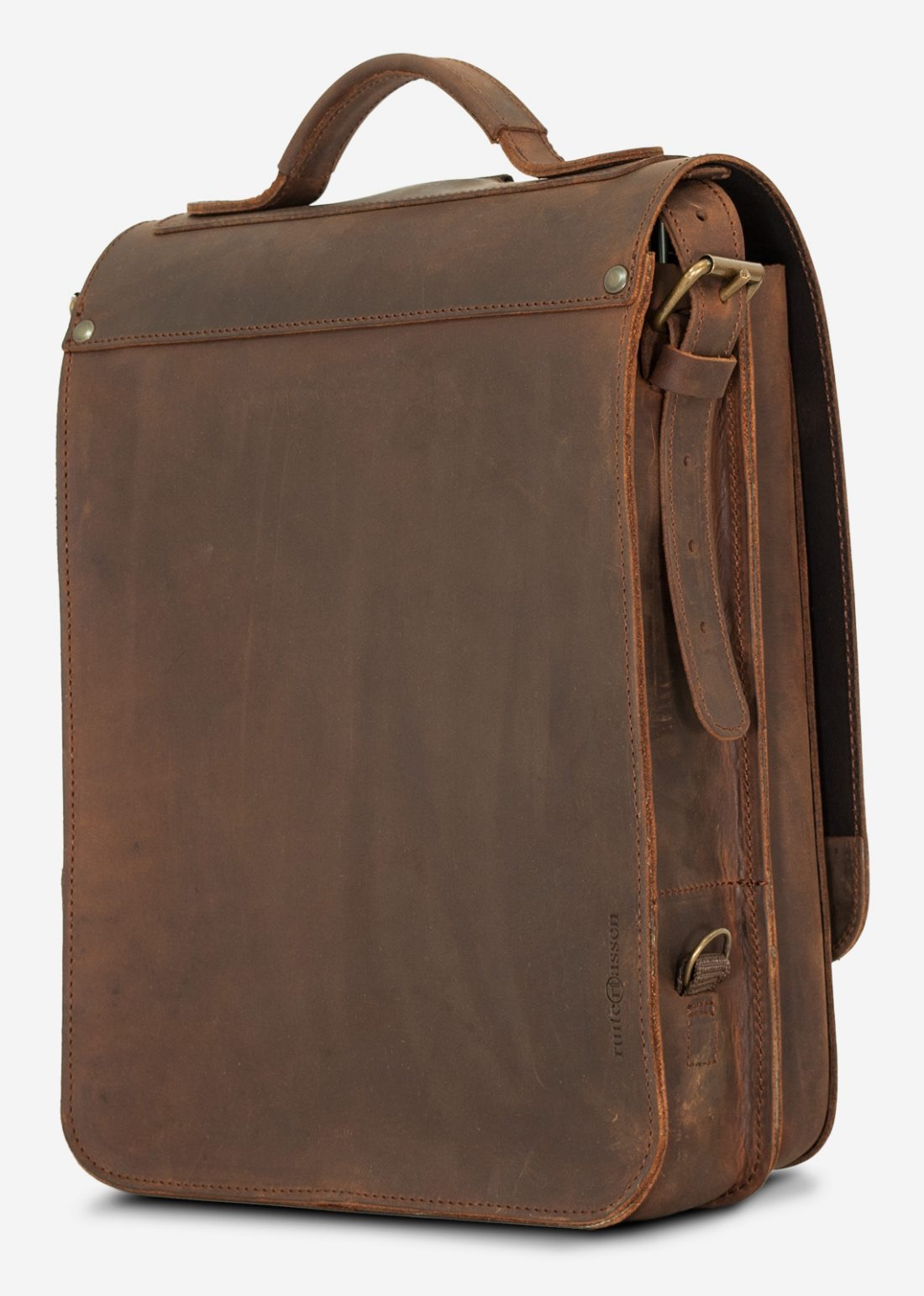 Back view of the vegetable-tanned brown leather backpack with shoulder belt.