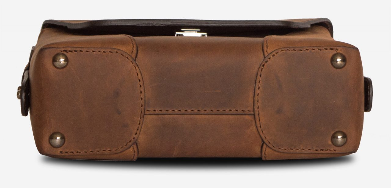 Below view of the small vegetable-tanned brown leather crossbody bag for men.
