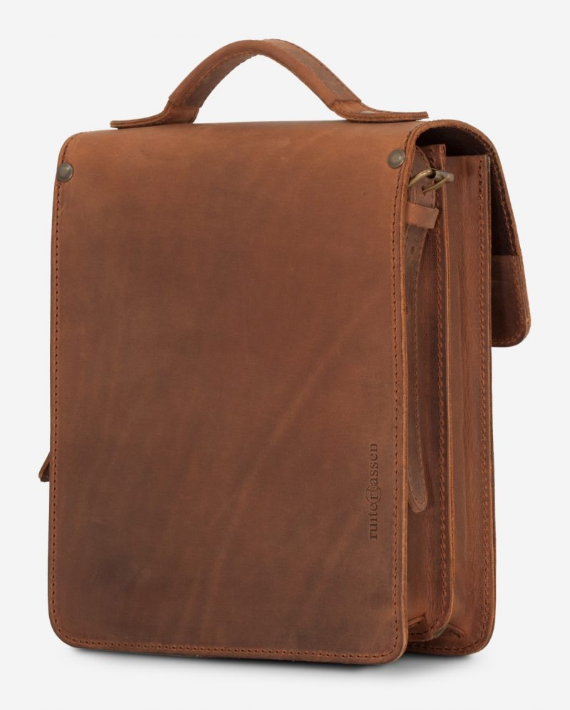 Back view of the handmade vegetable-tanned brown leather crossbody bag for men.
