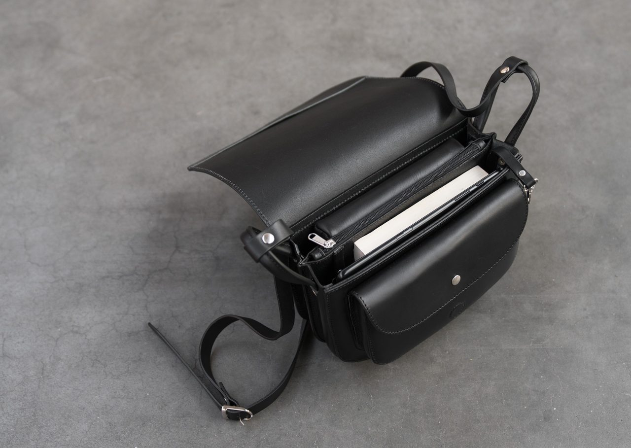 Top view of the large black leather shoulder bag for women.