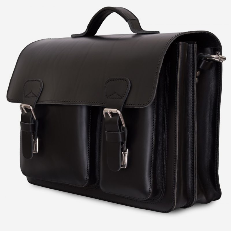 Side view of black leather laptop satchel bag with 2 gussets and asymmetric front pockets 112337.