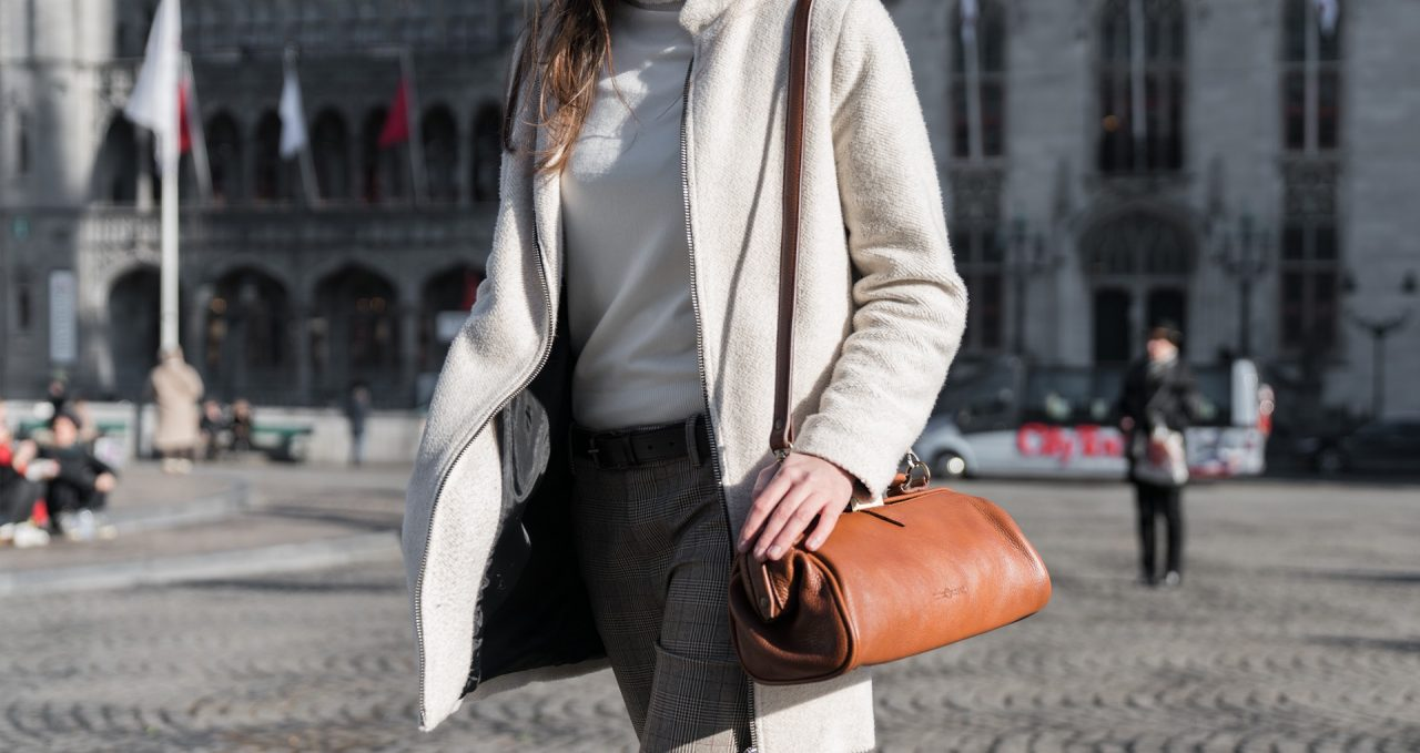 Woman wearing the soft brown leather doctor bag.