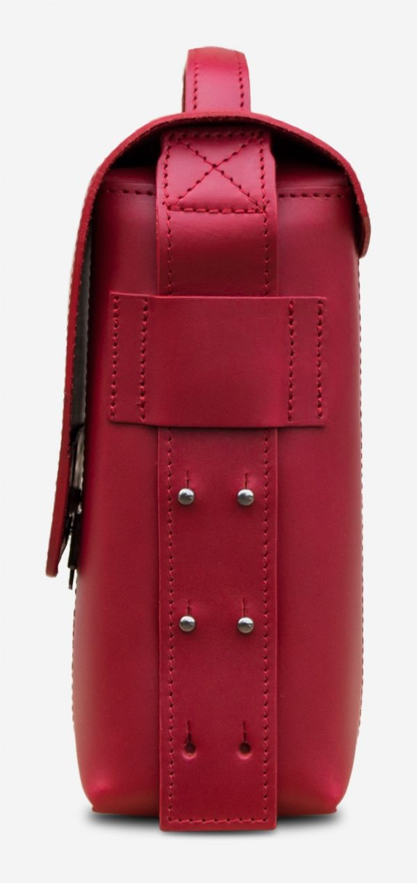 Side view of the elegant red vegetable-tanned leather briefcase bag with laptop pocket for women.