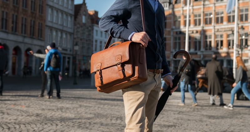 """Man wearing the 15"""" soft brown leather satchel briefcase."""