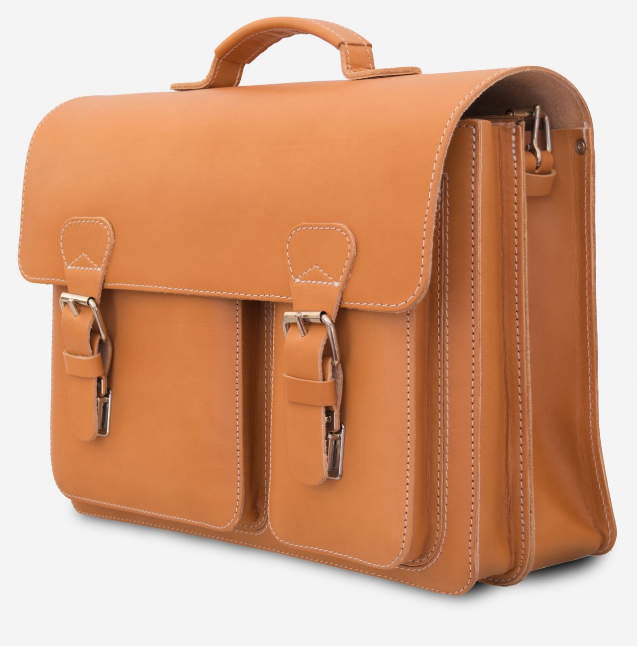 Side view of tan leather satchel with 2 compartments and 2 front asymmetric pockets.