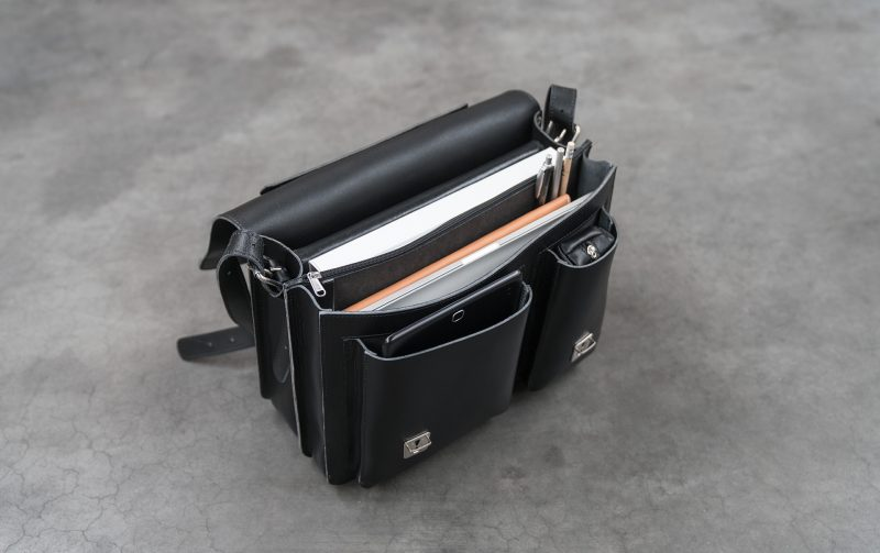 Open black leather satchel briefcase with asymmetric front pockets 112137.