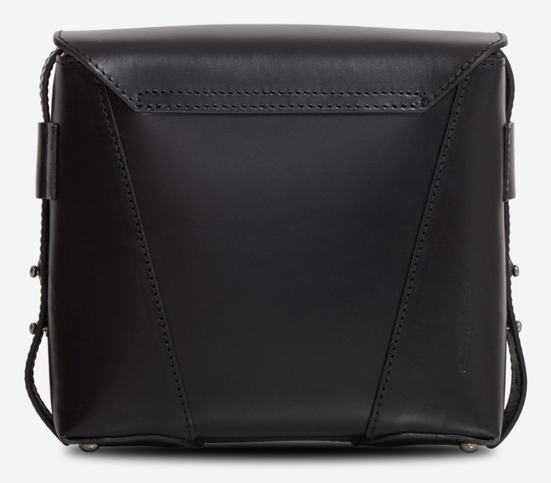 Back view of the small black vegetable-tanned leather crossbody bag.