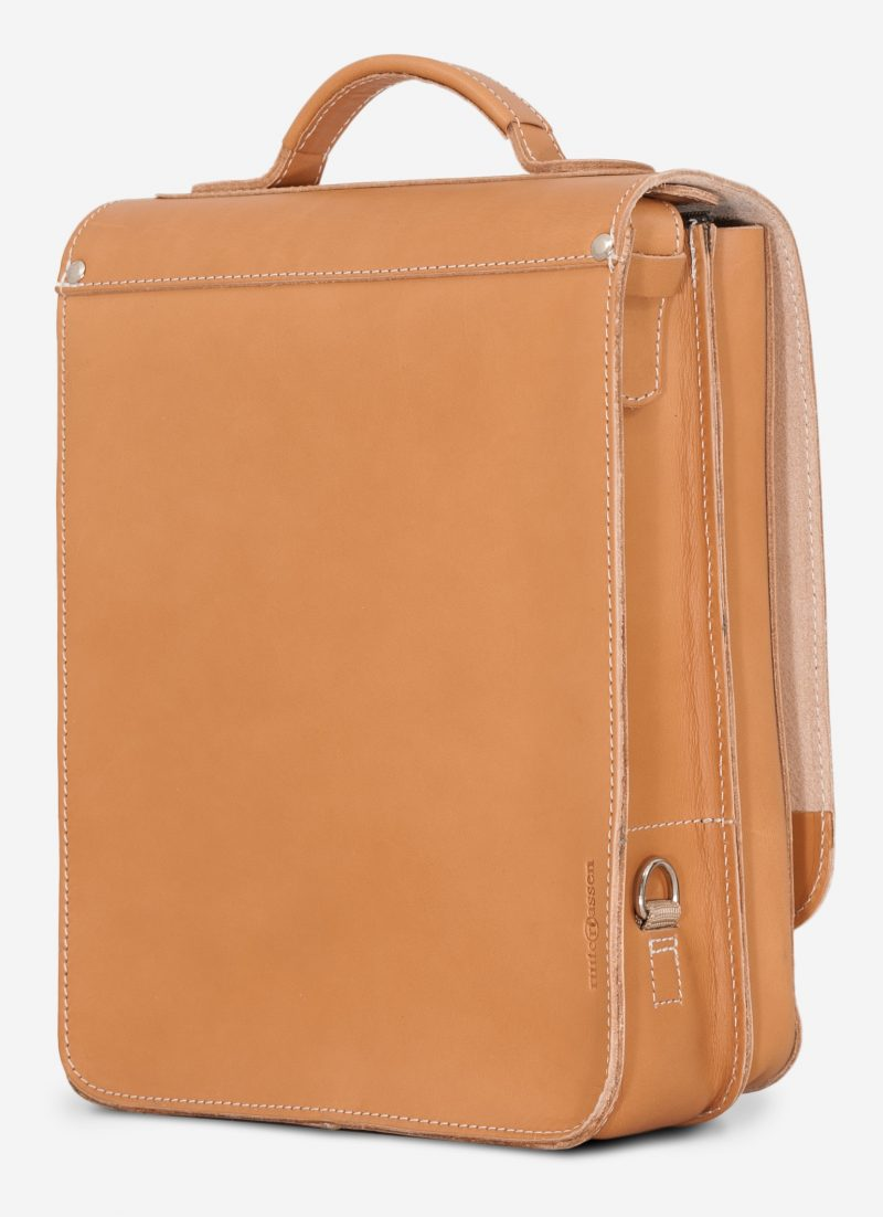 Back of the vegetable tanned leather backpack with shoulder belt.